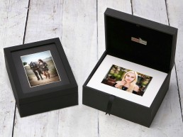 black image box of portraits with white matts