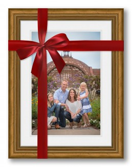 framed family portrait wrapped in a red gift bow